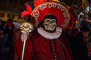 New York, NY - 31 October 2015. A man with a death's head mask and carrying a staff with a replica skull on it in the annual Greenwich Village Halloween Parade.