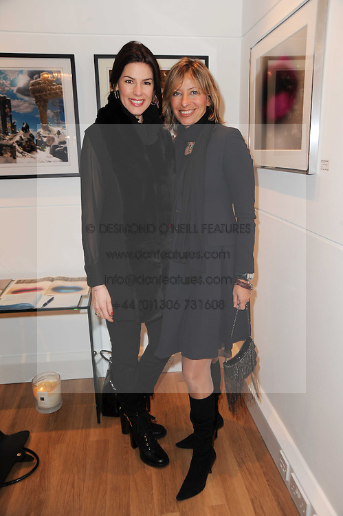 Left to right, CHRISTINA ESTRADA-JUFFALI and MAYA FIENNES at a private view of photographs held at the Little Black Gallery, Park Walk, London on 20th January 2010.