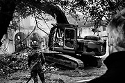 Bulldozers demolish one of illegally built villas seized by Rome police to the Casamonica mafia clan in the south-eastern suburb Quadraro district of Rome on November 26, 2018.  Christian Mantuano / OneShot