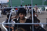 Red Cross camps in southern Italy<br /><br />Kosovar Roma Gypsy refugees who came to Italy via Mafia boats from Montenegro after the Kosovo war in 1999. Others lived in the no-mans land during the Bosnia war. They lived for years in UNHCR refugee camps. They are living with racism, prejudice and displacement from their homes. Many came to Italy from the Balkans in search of a new life after the violent disintegration of ex-yugoslavia. Since then they have been forced from their urban camps to live in Container camps outside cities. Brindisi and Bari, southern Italy 1999