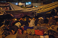 Morsi supporters sleep during a 'sit-in' around Rabaa el Adawiya Mosque in Nassr City, Cairo. Many people came to Cairo from other cities on busses that have since left, without them.