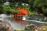 Orange bridge over a small lake leading to the Golden Pagoda, Nan Lian Garden, Kowloon (Diamond Hill), Hong Kong, August 2008. The Nan Lian garden is built on a classical design of the Tang Dynasty, with rocks, ponds, and plantings.   Photo: Peter Llewellyn