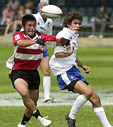 Oxford, England.<br /> <br /> IRB U21 Rugby World Cup - Iffley Road - Oxford <br /> 21.06.2003. Italy vs Japan, [Mandatory Credit: Peter SPURRIER/Intersport Images] <br /> Tomoki Yosida left and Andrea Brancoli tussle for the loose ball