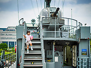 08 JUNE 2018 - SEOUL, SOUTH KOREA: A school girl at the War Memorial of Korea in Seoul, South Korea, walks down the stairs on a replica of the PKM-357 patrol boat sunk by the North Korean navy in 2002. With the near constant threat of invasion from North Korea, many South Koreans take great pride in the ability of their armed forces. Some observers believe there is a possibility that a peace agreement between South and North Korea could be signed following the Trump/Kim summit in Singapore. The War Memorial and museum opened in 1994 on the former site of the army headquarters to exhibit and memorialize the military history of Korea. When it opened in 1994 it was the largest building of its kind in the world. The museum features displays about the Korean War and many static displays of military equipment.    PHOTO BY JACK KURTZ