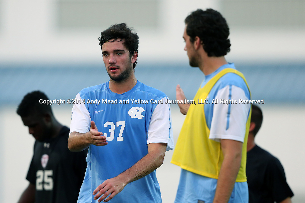 15 August 2014: North Carolina's Walker Hume (37) and his twin brother Tucker Hume (right). The University of North Carolina Tar Heels hosted the Gardner-Webb University Bulldogs at Fetzer Field in Chapel Hill, NC in a 2014 NCAA Division I Men's Soccer preseason match. North Carolina won the exhibition 7-0.