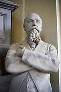 Picture and image of a stone sculpture of Giuseppe Recagno in a Borgeois Realistic style. The monumental tombs of the Staglieno Monumental Cemetery, Genoa, Italy .<br /> <br /> Visit our ITALY PHOTO COLLECTION for more   photos of Italy to download or buy as prints https://funkystock.photoshelter.com/gallery-collection/2b-Pictures-Images-of-Italy-Photos-of-Italian-Historic-Landmark-Sites/C0000qxA2zGFjd_k<br /> If you prefer to buy from our ALAMY PHOTO LIBRARY  Collection visit : https://www.alamy.com/portfolio/paul-williams-funkystock/camposanto-di-staglieno-cemetery-genoa.html