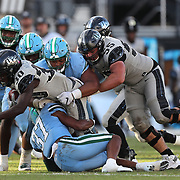 ORLANDO, FL - OCTOBER 24: Running back Greg McCrae #30 of the Central Florida Knights gets help from  offensive lineman Matthew Lee #55 of the Central Florida Knights against the Tulane Green Wave defense at Bounce House-FBC Mortgage Field on October 24, 2020 in Orlando, Florida. (Photo by Alex Menendez/Getty Images) *** Local Caption *** Greg McCrae; Matthew Lee