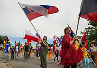The Parade of Flags to celebrate Laconia's cultural diversity marches through downtown during the annual Multicultural Festival Saturday.  (Karen Bobotas/for the Laconia Daily Sun)