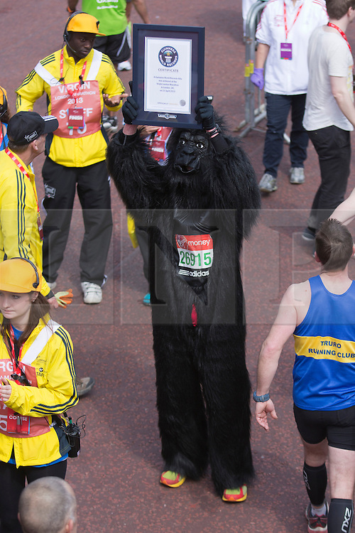 © Licensed to London News Pictures. 21/04/2013. London, England. Picture: Runners attempting Guinness World Records. Celebrity Runners and Fun Runners finish the Virgin London Marathon 2013 race in the Mall, London. Many wore black ribbons to pay their respect for those who died or were injured in the Boston Marathon. Photo credit: Bettina Strenske/LNP