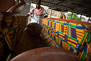 Daniel Oblie, owner of Hello Design Coffins, opens the back of a tanker truck-shaped coffin at his workshop in Teshie, on the outskirts of Ghana's capital Accra, on Tuesday December 9, 2008. Is it a tradition in Ghana to bury people in coffins shaped to represent their life's work. For instance, the owner of an fuel company would be buried in a tanker-truck coffin, a cocoa farmer in one shaped as a cocoa pod.