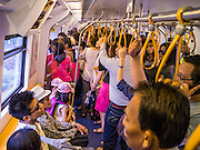"04 APRIL 2013 - BANGKOK, THAILAND:  Commuters ride the BTS Skytrain in Bangkok. The Skytrain is one of Bangkok's ""soft targets"" as there is no security on the trains and only cursory security in the stations. The United States' Federal Bureau of Investigation (FBI)  has warned the Thai government that Thailand has the greatest risk of a terror attack in Asia and the fifth greatest in the world. According to a statement from the Thai government the assessment is based on Thailand's relative freedoms and ease of movement in Thailand. In response to the report, Deputy Prime Minister Chalerm Yubamrung announced plans to set up an anti-terror center in Bangkok and work with Thai immigration to institute tougher screening on foreigners entering Thailand. In February 2012, terrorists thought to be connected with the Iranian government were arrested in Bangkok after the house they were living in blew up. At the time, Thai authorities said they suspected it was a bomb factory.     PHOTO BY JACK KURTZ"