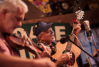 """James Pero on fiddle and Duane Johnson on guitar perform during the annual """"Duanestock"""" held in Johnson's 133 year old barn on Saturday.  (Karen Bobotas/for the Laconia Daily Sun)"""