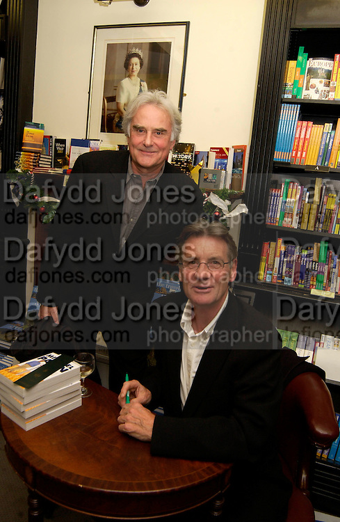 Sir Richard Eyre, Michael Palin, Hatchards christmas party, Piccadilly, 4 December 2003. © Copyright Photograph by Dafydd Jones 66 Stockwell Park Rd. London SW9 0DA Tel 020 7733 0108 www.dafjones.com