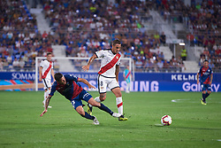 September 14, 2018 - Huesca, U.S. - HUESCA, SPAIN - SEPTEMBER 14: Musto, midfielder of SD Huesca competes for the ball with Trejo, midfielder of Rayo Vallecano de Madrid during the La Liga game between SD Huesca and Rayo Vallecano de Madrid  at Estadio El Alcoraz on September 14, 2018, in Huesca, Spain. (Photo by Carlos Sanchez Martinez/Icon Sportswire) (Credit Image: © Carlos Sanchez Martinez/Icon SMI via ZUMA Press)
