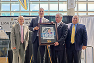 Garden City, NY, USA. June 21, 2018. L-R, JOSHUA STOFF, Curator of Cradle of Aviation Museum; former NASA astronaut MICHAEL MASSIMINO; ANDREW PARTON the Executive Director of CAM; and GREG SANTI, the Human Resources Manager at Curtiss Wright pose with official illustration of Long Island Air & Space Hall of Fame inductee Massimino at 10th Annual Luncheon at Cradle of Aviation.