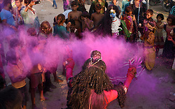 September 4, 2017 - Allahabad, Uttar Pradesh, India - A Devotee throw color powder on another as they carrying Elephant headed Hindu God Ganesha's idol to immerse in a pond on the occasion of Anant Chaturdasi festival celebration. (Credit Image: © Prabhat Kumar Verma via ZUMA Wire)