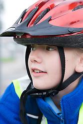 Girl wearing a cycling helmet,