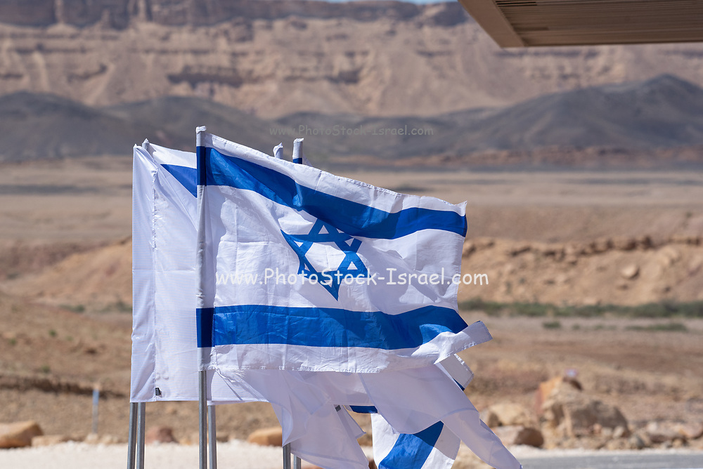 Israeli flags blowing in the wind. Photographed in the Negev Desert, Israel