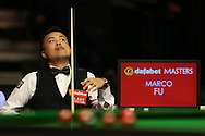 Marco Fu (HK) looks on from his seat.  Marco Fu (HK) v Mark Allen (NI) , Quarter-Final match at the Dafabet Masters Snooker 2017, at Alexandra Palace in London on Thursday 19th January 2017.<br /> pic by John Patrick Fletcher, Andrew Orchard sports photography.