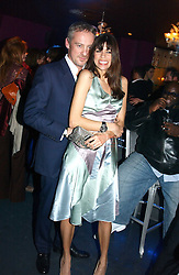 ANTON BILTON and his wife LISA BARBUSCIA at a party hosted by Panerai and the Baglioni Hotel, 60 Hyde Park Gate, London on 6th December 2004.<br />