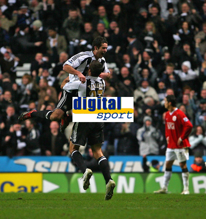 Photo: Andrew Unwin.<br /> Newcastle United v Manchester United. The Barclays Premiership. 01/01/2007.<br /> Newcastle's David Edgar (top) celebrates scoring his team's second goal.