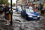 Heavy rain causes flash flooding in Stoke Newington, North London. Traffic struggled through more than 1' of rain water as torrential rain flooded the area.