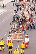 """03 DECEMBER 2011 - PHOENIX, AZ:  A procession to honor the Virgin of Guadalupe in downtown Phoenix Saturday. The Phoenix diocese of the Roman Catholic Church held its Sixth Annual Honor Your Mother Day Saturday to honor the Virgin of Guadalupe. According to Mexican Catholic tradition, on December 9, 1531 Juan Diego, an indigenous peasant, had a vision of a young woman while he was on a hill in the Tepeyac desert, near Mexico City. The woman told him to build a church exactly on the spot where they were standing. He told the local bishop, who asked for some proof. He went back and had the vision again. He told the lady that the bishop wanted proof, and she said """"Bring the roses behind you."""" Turning to look, he found a rose bush growing behind him. He cut the roses, placed them in his poncho and returned to the bishop, saying he had brought proof. When he opened his poncho, instead of roses, there was an image of the young lady in the vision. The Virgin is now honored on Dec 12 in Catholic churches throughout Latin America and in Hispanic communitied in the US.     PHOTO BY JACK KURTZ"""