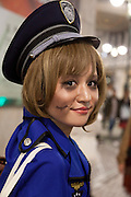 A young woamn dressed in a police woman's costumes to celebrate Halloween in Shibuya, Tokyo, Japan. Thursday, October 31st 2013