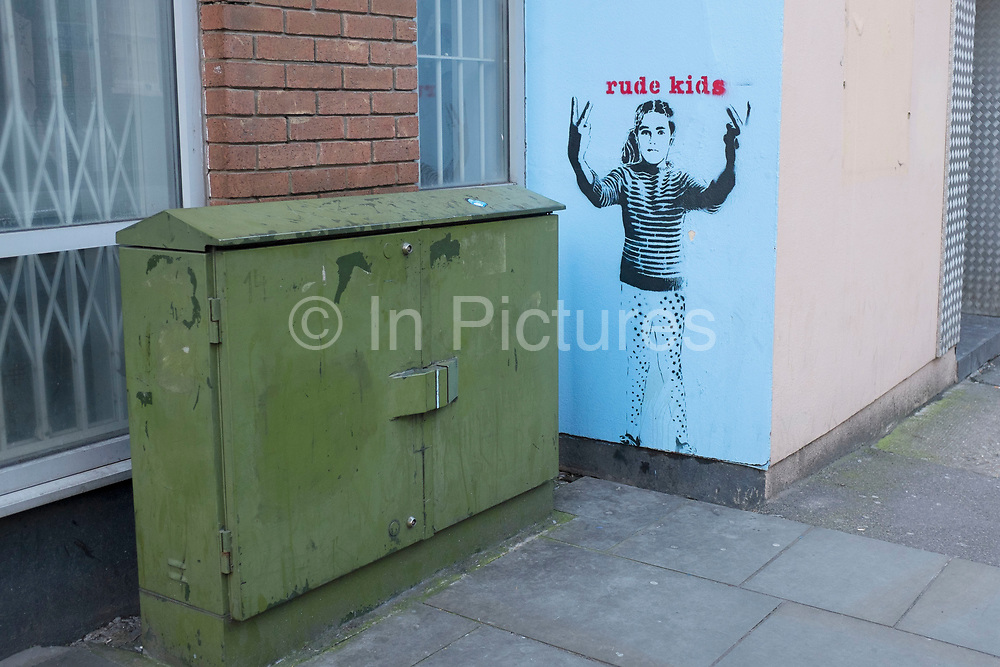 Street art work entitled Rude Kids on Bermondsey Street in Southwark, London, UK. This street is a very gentrified and trendy stylish area.