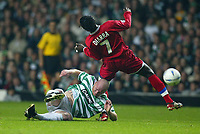 Photo. Aidan Ellis.<br />Celtic v Lyon.<br />UEFA Champions League Group A Phase 1.<br />30/09/2003.<br />Celtic's John Hartson and Lyon's Mahamadou Diarra