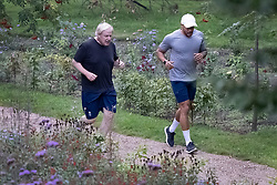 © Licensed to London News Pictures. 16/09/2020. London, UK. Prime Minister Boris Johnson runs with his trainer Harry Jameson in Westminster, central London. Later Mr Johnson will face MP's questions in Parliament. Photo credit: Peter Macdiarmid/LNP