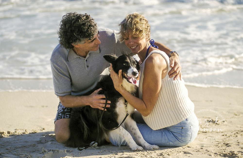 USA, Hawaii, Oahu, Kailua Beach, couple (50's) w/dog.  MR available people *****Property Release available ****Model Release available