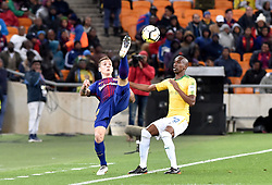 Mamelodi Sundowns player Anele Ngcongca and Barcelona FC player Lucas Digne battle for the ball during Mandela Centenary Cup at FNB stadium, Gauteng.<br />Picture: Itumeleng English/African News Agency (ANA)