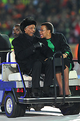 Jul 11, 2010 - Johannesburg, Gauteng, South Africa - NELSON MANDELA and his wife GRACA MACHEL ride a golf cart during the closing ceremony of the 2010 FIFA World Cup. As of June 8, 2013 the Former South African President is in serious condition after the recurrence of a lung infection. (Credit Image: © Roger Sedres/Images SA/ZUMAPRESS.com)