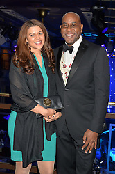 AINSLEY HARRIOTT and his daughter MADELEINE HARRIOTT at the Chain of Hope Gala Ball held at The Grosvenor House Hotel, Park Lane, London on 18th November 2016.