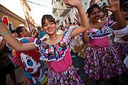Traditional dancers parade through the streets of Old San Juan during the Festival of San Sebastian in San Juan, Puerto Rico.