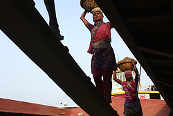 May 5, 2017 - Dhaka, Bangladesh - A female worker carry sand unloaded from a ferry. (Credit Image: © Kazi Salahuddin Razu/Pacific Press via ZUMA Wire)