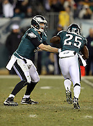 Philadelphia Eagles quarterback Nick Foles (9) hands off the ball to Philadelphia Eagles running back LeSean McCoy (25) during the NFL NFC Wild Card football game against the New Orleans Saints on Saturday, Jan. 4, 2014 in Philadelphia. The Saints won the game 26-24. ©Paul Anthony Spinelli