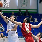 Anadolu Efes's Sasha VUJACIC (L) during their Turkey Cup Qualifying basketball second match Anadolu Efes between Pinar Karsiyaka at Aliaga Arena in Izmir, Turkey, Monday, October 10, 2011. Photo by TURKPIX