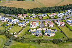 Aerial view of  luxury housing estate adjacent to Archerfield Links golf course near North Berwick in East Lothian, Scotland, UK