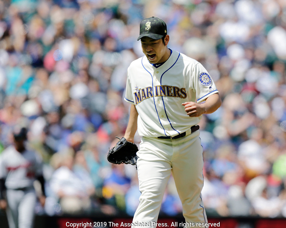 Seattle Mariners starting pitcher Yusei Kikuchi reacts after striking out Minnesota Twins' Ehire Adrianza for the third out of the fourth inning of a baseball game, Sunday, May 19, 2019, in Seattle. The Mariners won 7-4. (AP Photo/John Froschauer)