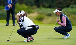 Auchterarder, Scotland, UK. 14 September 2019. Saturday morning Foresomes matches  at 2019 Solheim Cup on Centenary Course at Gleneagles. Pictured; Lizette Salas of USA and Georgia Hall line up putts on the 9th green. Iain Masterton/Alamy Live News