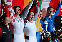 Photo: Catrine Gapper.<br />Winter Olympics, Turin 2006. Womens Bobsleigh. 21/02/2006. <br />Gerda Weissensteiner and Jennifer Isacco of Italy, Shauna Rohbock and Valerie Flemin of USA and Sandra Kiriasis and Anja Schneiderheinze of Germany, celebrate their medals.