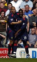 Photo. Jed Wee.<br /> Leeds United v Portsmouth, FA Barclaycard Premiership, 25/04/2004.<br /> Portsmouth's Aiyegbeni Yakubu (R) celebrates after scoring with team mate Nigel Quashie..