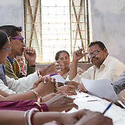 CAPTION: Community COPE members discuss steps being taken by Dr Ram Chandra Soren, the Medical Officer-in-Charge, and the sahiyas to deal with the problem of snake and dog bites. Dr Ram has explained that medicines are on the way, so the members are now discussing how the Community COPE team can assist with ensuring people get the knowledge they need on obtaining the necessary medicines from the hospital. Most of the time, people go for magical solutions through faith healers. Many people have died from these bites (including from rabies) in this area. LOCATION: Pawra (village), Ghatshila (block), Purbi Singhbhum (district), Jharkhand (state), India. INDIVIDUAL(S) PHOTOGRAPHED: Multiple people.