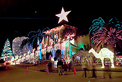 9th December, 2005. New Orleans, Louisiana. Post hurricane Katrina light after the storm. Al Copeland, controversial wealthy local businessman and owner of several 'Copeland's' restaurants in the city puts on his famous light display at his house to the west of the city. Copeland insisted on having the show to help cheer the childen of the city, many of whom will have come to the display for years.