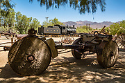 "Pioneer-era mining and transportation equipment at the Borax Museum at Furnace Creek Ranch, in Death Valley National Park, California, USA. The oldest house in Death Valley was built in 1883 by F.M. ""Borax"" Smith in Twenty Mule Team Canyon, then moved here by his Pacific Coast Borax Company in 1954 to serve as a museum."