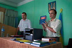 Paralegals and attorneys from the Rivne Community Law Center, bring supplies including books and a copy/fax machine to a local village community center where they are training school teachers, Zhovtneve, Ukraine, June 15, 2011. School teachers are often the most educated people in rural areas, and act as paralegals to help local communities with their legal issues. More than half of the worldÕs population, four billion people, live outside the rule of law, with no effective title to property, access to courts or redress for official abuse. The Open Society Justice Initiative is involved in building capacity and developing pilot programs through the use of community-based advocates and paralegals in Sierra Leone, Ukraine and Indonesia. The pilot programs, which combine education with grassroots tools to provide concrete solutions to instances of injustice, help give poor people some measure of control over their lives.