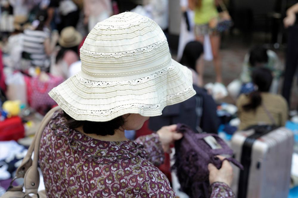 woman shopping at an outdoors flee market