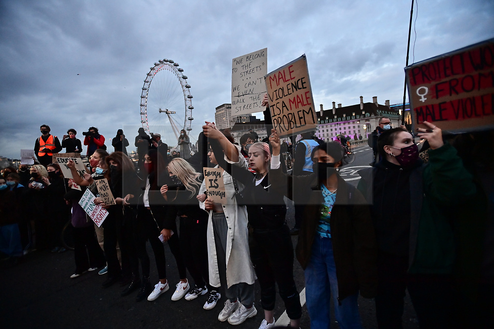 © Licensed to London News Pictures. 15/03/2021. London, UK. Protestors gather On Westminster Bridge in London for a second day of demonstrations following the actions of the police force at a vigil for murdered Sarah Everard on Saturday evening. There have been calls for Met Chief Cressida Dick to resign after police dragged women away from a bandstand at a vigil for murdered Sarah Everard in Clapham, South London. Photo credit: Ben Cawthra/LNP